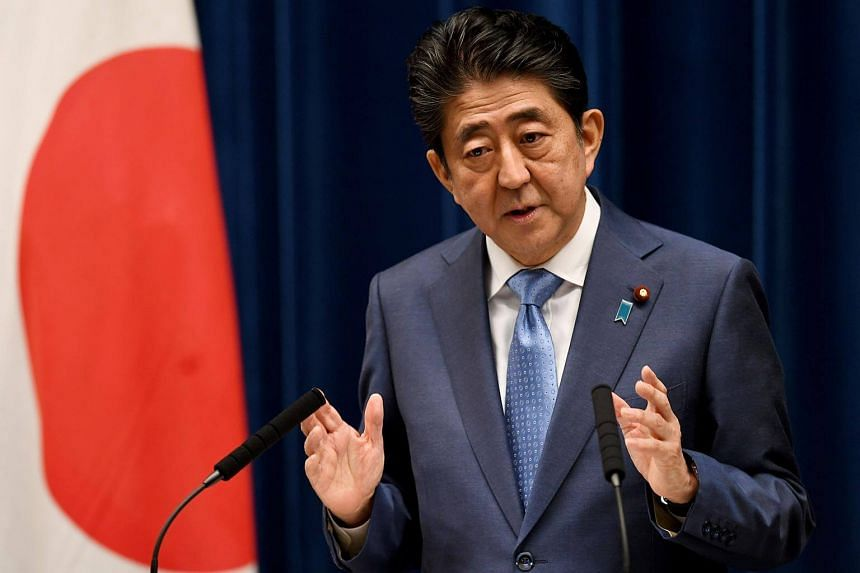 Japan's Prime Minister Shinzo Abe answers a question during a press conference at his official residence in Tokyo, on June 19, 2017.