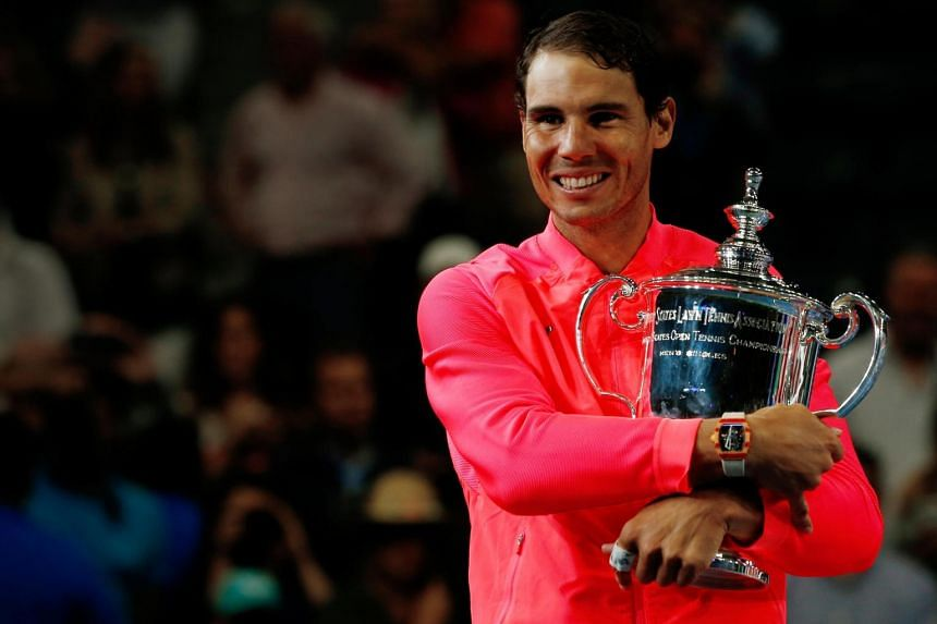 Rafael Nadal of Spain holds the trophy after defeating Kevin Anderson of South Africa.