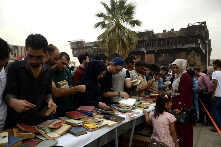Visitors at a Book Fair at the headquarters of Mosul university, on Sept 6, 2017.