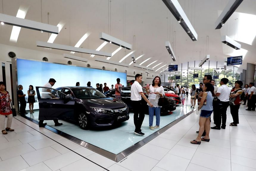 Car showrooms were packed over the weekend as buyers sought to take advantage of lower certificate of entitlement (COE) prices.