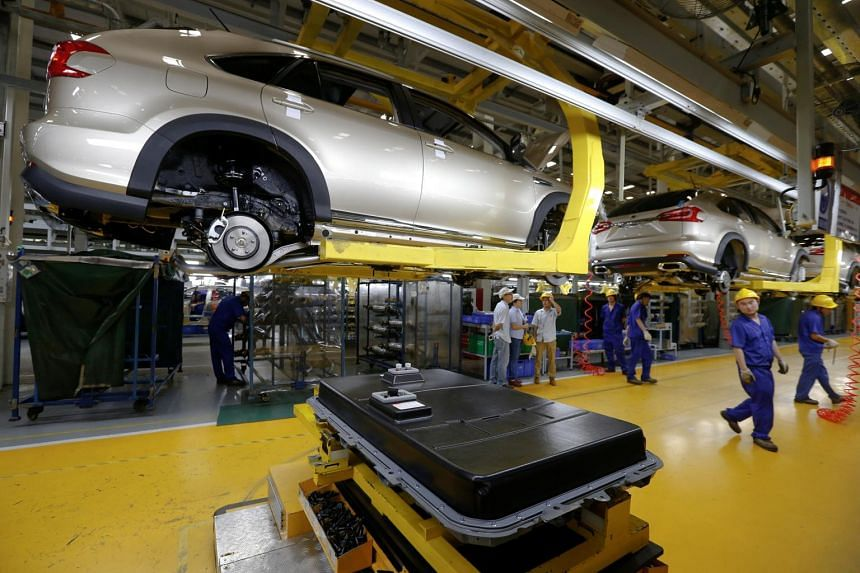 A battery is about to be installed on a electric car at a BYD assembly line in Shenzhen, China, on May 25, 2016.