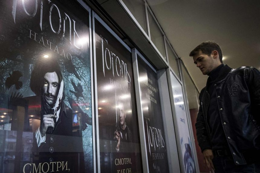 A man walks past posters of the Gogol. The Start film as he enters a cinema in Moscow, on Sept 5, 2017.