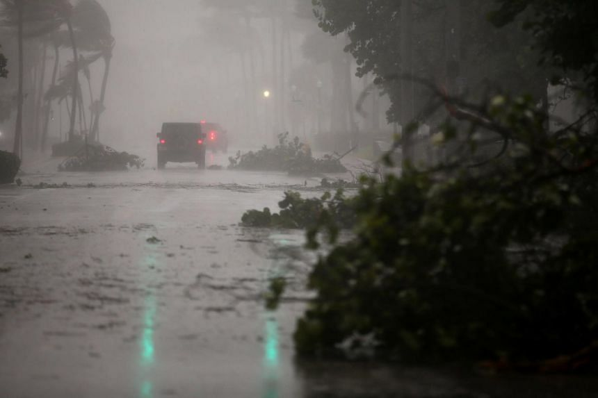 Vehicles driving along Ocean Drive in South Beach as Hurricane Irma arrives at south Florida, in Miami Beach, Florida, on Sept 10, 2017.