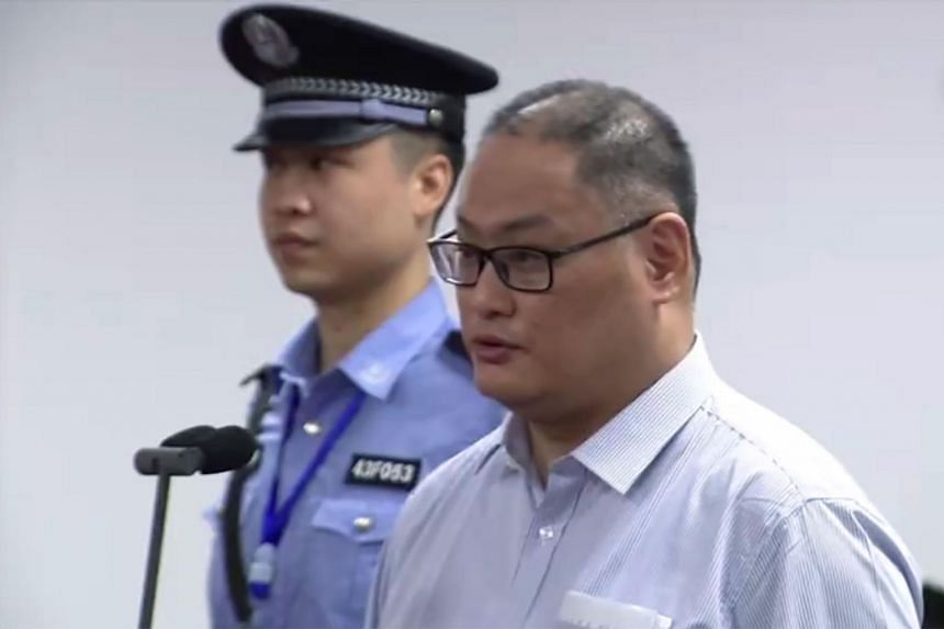 Taiwanese activist Lee Ming-cheh (right) appearing in court in Yueyang, Hunan on Sept 11, 2017.