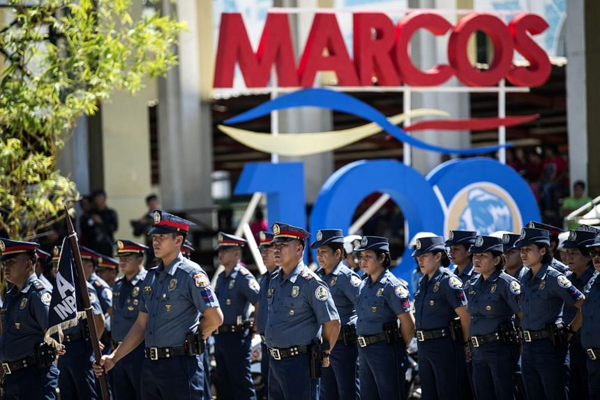 Policemen stand in formation during celebrations to mark the 100th birthday of late dictator Ferdinand Marcos in Batac, Ilocos Norte province, north of Manila on Sept 10, 2017.