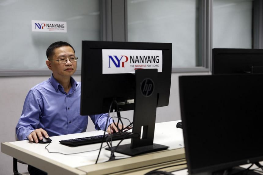 Part-time Nanyang Polytechnic student Lee Sheng Loong, 46, who is studying infocomm and digital media.