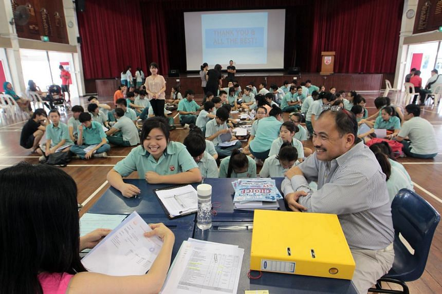 Si Ling Secondary School students receiving their GCE O-level examination results at the school hall, on Jan 13, 2014.