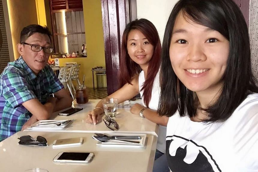 Ms Carmen Mark (right), with her mother Ariess Tan and father Mark Kok Wah.