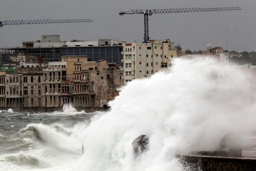 Waves crash against the seafront boulevard El Malecon ahead of the passing of Hurricane Irma, in Havana, Cuba on Sept 9, 2017.