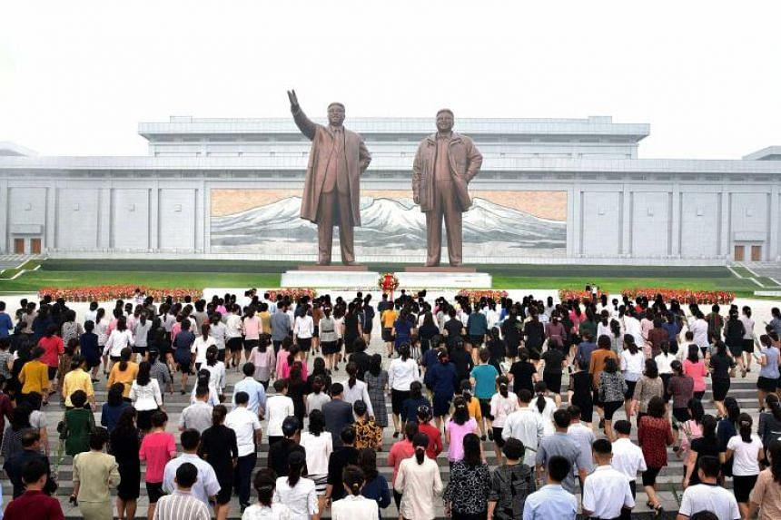 North Koreans pay tribute at the monuments of North Korea's late leaders Kim Il-sung and Kim Jong-il in Pyongyang, North Korea, on Sept 9, 2017 to mark the 69th anniversary of the government's establishment.