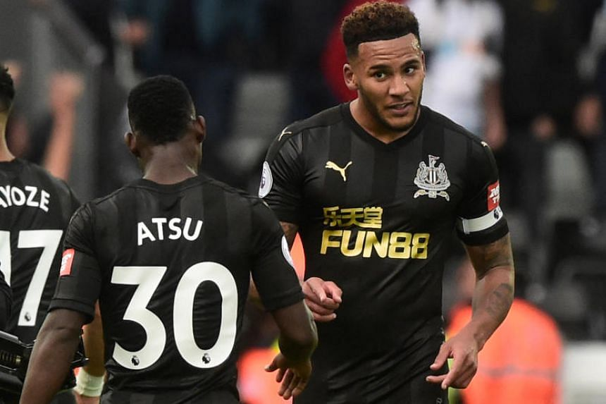 Newcastle United's Jamaal Lascelles celebrates victory over Swansea City on Sept 10, 2017.