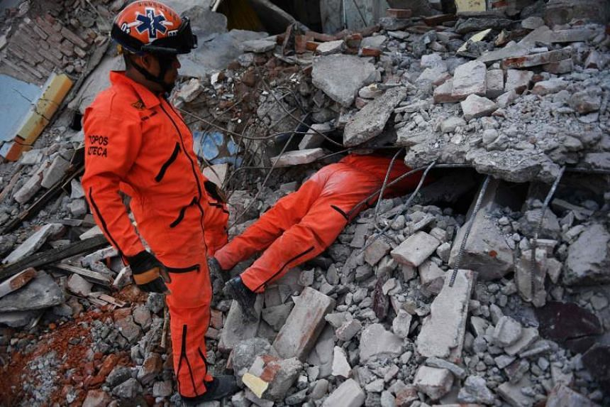 Rescuers search in the rubble in the Juchitan municipality, in Oaxaca, Mexico for victims of the earthquake.