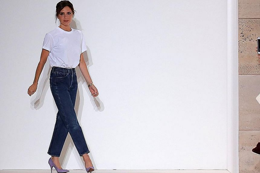Fashion designer Victoria Beckham (above) showed off hues and sparkly footwear in her new collection, which was unveiled in New York with her husband David and their son Brooklyn among audience members.