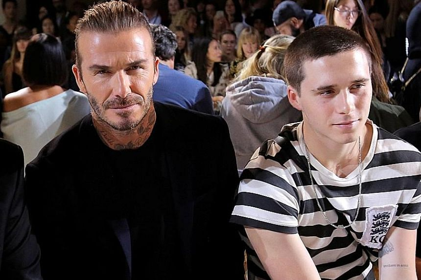 Fashion designer Victoria Beckham showed off hues and sparkly footwear in her new collection, which was unveiled in New York with her husband David and their son Brooklyn (both above) among audience members.