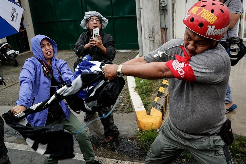 """Riot police yesterday blocked hundreds of protesters trying to prevent the family of the late dictator Ferdinand Marcos from celebrating the 100th anniversary of his birth at the Philippines' """"Heroes Cemetery"""" south of Manila. President Rodrigo Duter"""