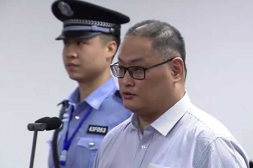 A video grab from the website of Yueyang Intermediate People's Court taken yesterday showing Taiwanese activist Lee Ming-che at his trial in Yueyang, China's central Hunan province.