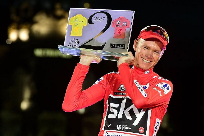 Team Sky's British cyclist Chris Froome celebrating on the podium on Sunday after winning the 72nd edition of the Tour of Spain. He is just the third rider to win the Vuelta a Espana and Tour de France in the same year.
