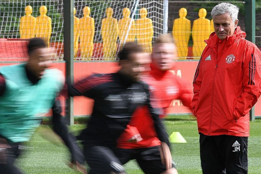 Manchester United manager Jose Mourinho overseeing training ahead of the Europa League holders' Champions League opener against Basel. The Portuguese has started the mind games on his rivals in Europe, citing differences in their respective domestic