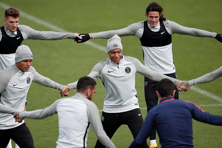 Paris Saint-Germain's Kylian Mbappe (centre) training with his new team-mates in preparation for today's Champions League clash with Celtic. He scored on his Ligue 1 debut against Metz following a loan move from Monaco.