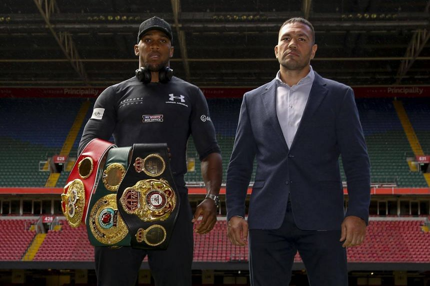 Britain's Anthony Joshua (left) and Bulgaria's Kubrat Pulev stand on the pitch at the Principality Stadium in Cardiff, on Sept 11, 2017, during a promotional event for their heavyweight world title boxing match.