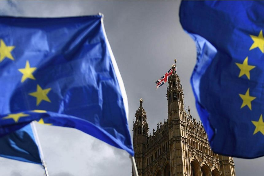 The European Union flags are pictured in front of Parliament in London, Britain, on Sept 11, 2017.