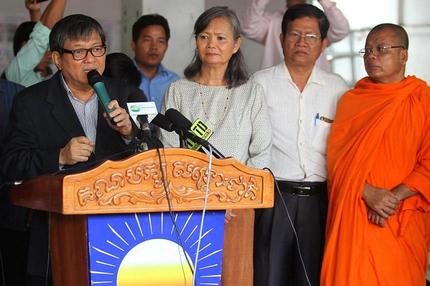 Opposition Cambodia National Rescue Party lawmaker Son Chhay (left) speaks during a news conference in Phnom Penh, Cambodia, on Sept 12, 2017.