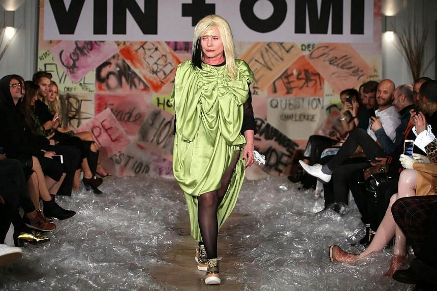US singer Debbie Harry walks down the catwalk of designers VIN + OMI during their Spring/Summer 2018 collection highlighting the issue of plastic waste in central London, on Sept 11, 2017.