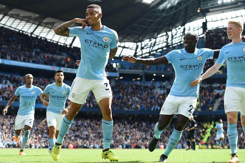 Manchester City's Brazilian striker Gabriel Jesus (third, left) celebrates with teammates after scoring their second goal, on Sept 9, 2017.