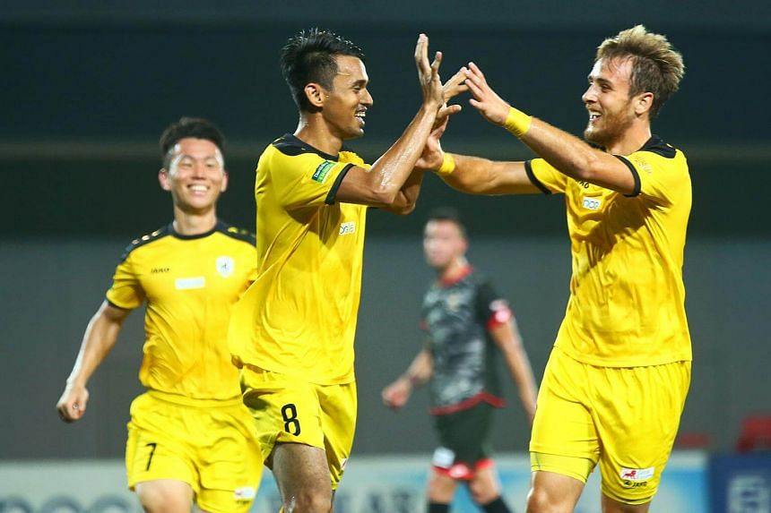 Tampines Rovers' Shahdan Sulaiman (centre) celebrating with teammate Ivan Dzoni after converting an 83rd-minute penalty in their Great Eastern-Hyundai S.League match against Brunei DPMM at Our Tampines Hub on July 28, 2017.