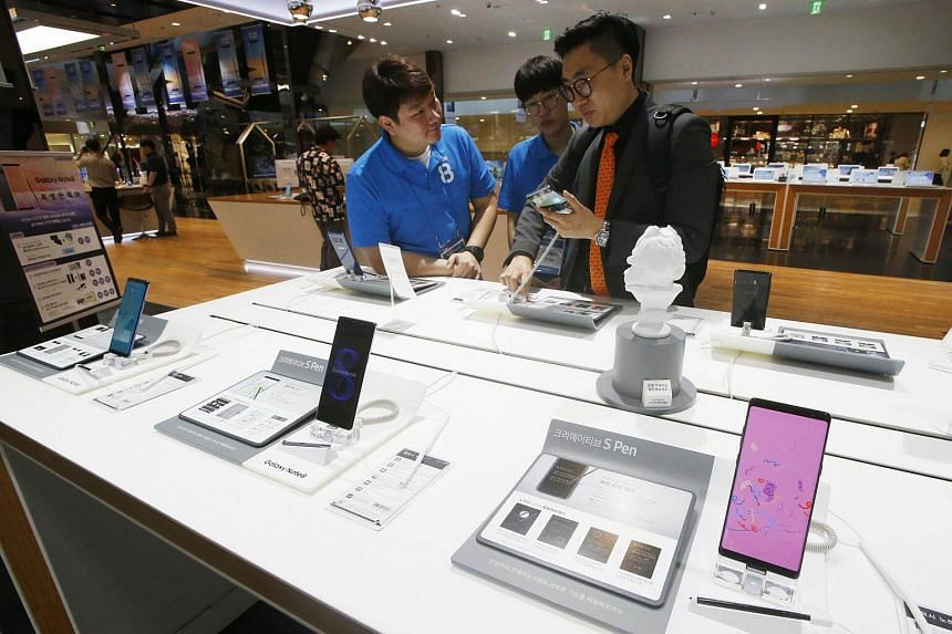South Koreans try the new Samsung Galaxy Note 8 at the Samsung Electronics headquarters in Seoul, on Sept 12, 2017.