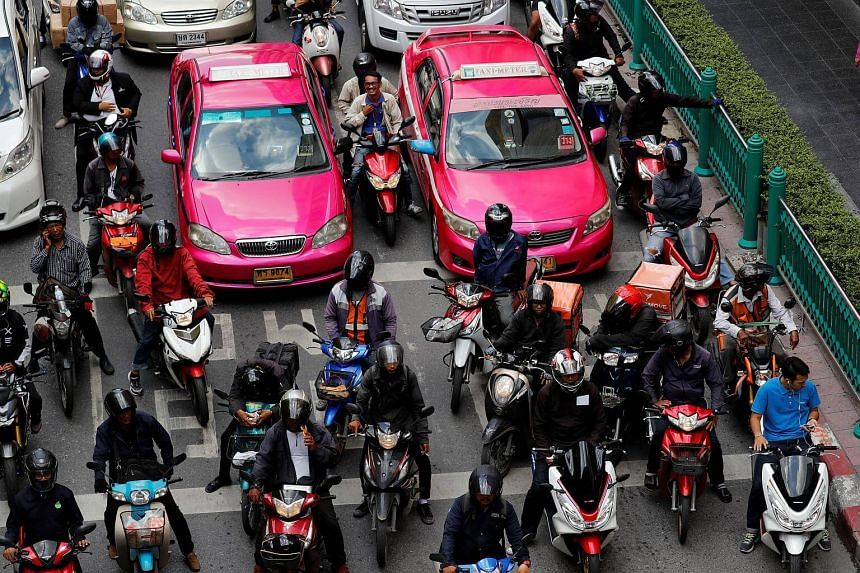 Motorbikes and cars wait at a red light in Bangkok, Thailand, on Sept 1, 2017.