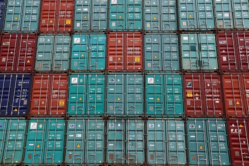 A stack of shipping containers are pictured in the Port of Miami in Miami, Florida, US, on May 19, 2016.