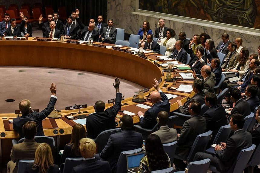 Ambassadors to the UN vote during a United Nations Security Council meeting on North Korea in New York City, US, on Sept 11, 2017.