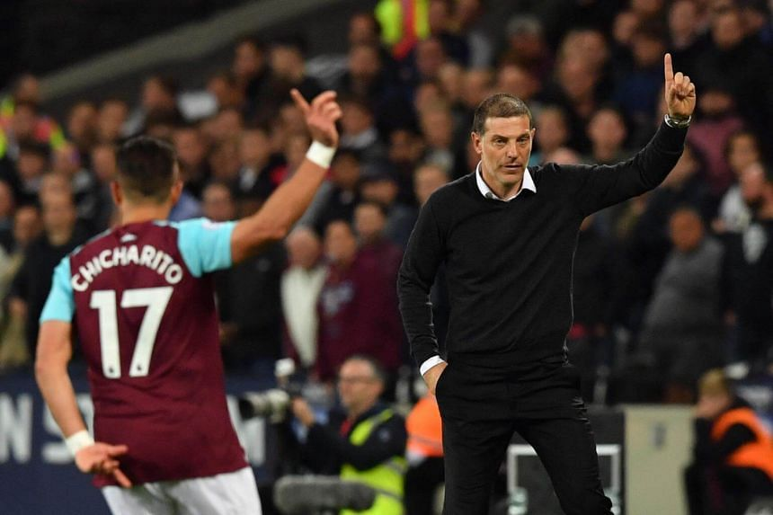 West Ham United's Mexican striker Javier Hernandez (left) and West Ham United's Croatian manager Slaven Bilic gesture during the match, on Sept 11, 2017.