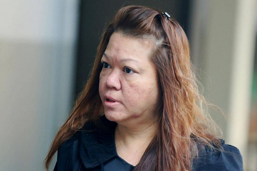 Wong Huey Min siphoned off $1.7 million over 6½ years and purportedly used the money to pay off her husband's gambling debts.