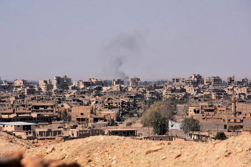 A general view of the eastern Syrian city of Deir Ezzor as Syrian government forces continue to press forward with Russian air cover in the offensive against Islamic State group jihadists across the province on Sept 11, 2017.