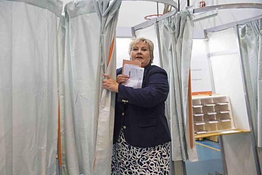 Norway's Prime Minister Erna Solberg leaves a polling booth as she votes at a polling station during general election in Bergen, Norway on Sept 11, 2017.
