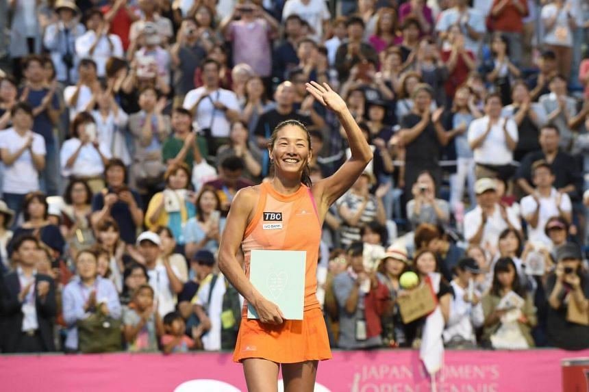 Japan's Kimiko Date waves to her fans during a ceremony after her last match of her career against Serbian Aleksandra Krunic in the first round of the Japan Wemen's Open tennis tournament in Tokyo on Sept 12, 2017.