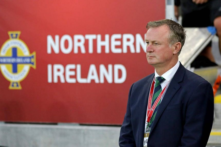 Northern Ireland's manager Michael O'Neill arrives for the World Cup 2018 qualification football match between Northern Ireland and Czech Republic at Windsor Park in Belfast, Northern Ireland on Sept 4, 2017.