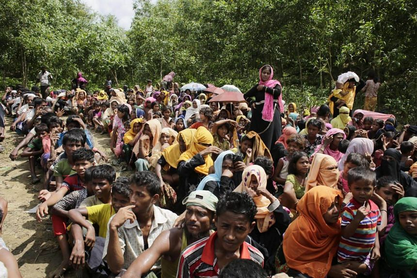 Rohingya refugees wait to receive relief goods during hot weather in Ukhiya, Cox's Bazar, Bangladesh on Sept 11, 2017.