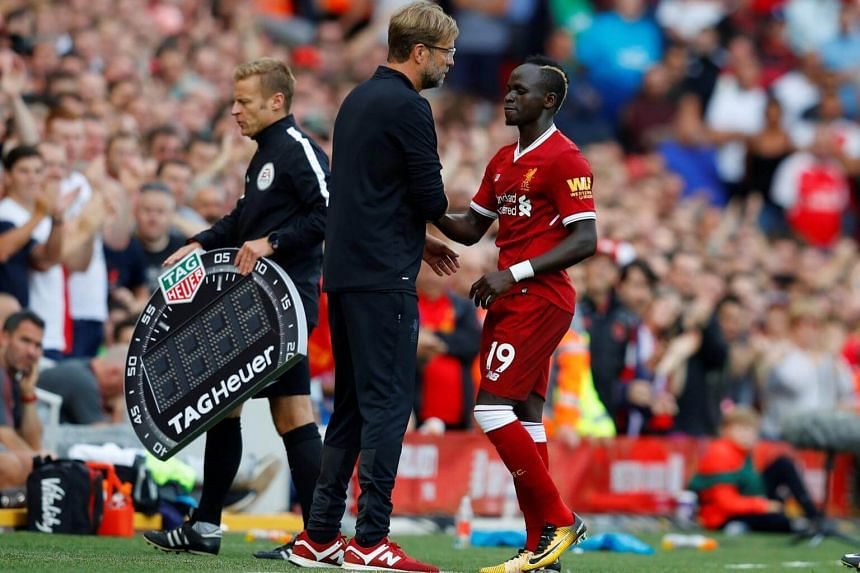 Liverpool's Sadio Mane embraces manager Juergen Klopp as he is substituted.