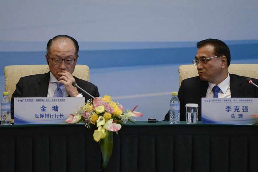 President of the World Bank Jim Yong Kim (left) and Chinese Premier Li Keqiang attend a press conference following the 1+6 Round Table Dialogue meeting at the Diaoyutai State Guesthouse in Beijing on Sept 12, 2017.