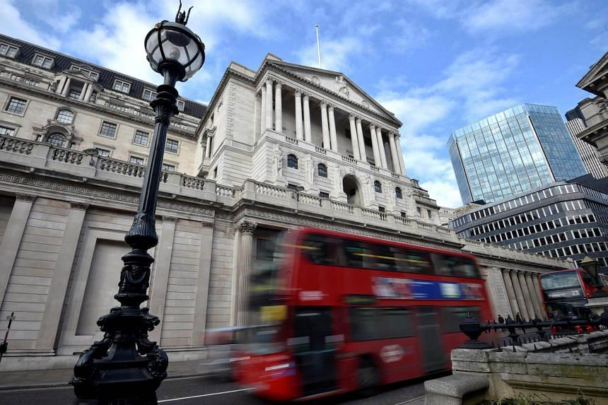 A bus passes the Bank of England in the City of London, Britain on Feb14, 2017.