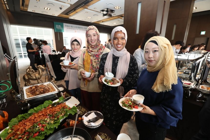Muslim bloggers sample halal food at a hotel in Seoul during an event organised by the Korea Tourism Organisation as part of its Halal Restaurant Week.