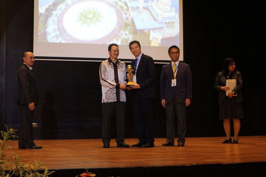 Mr Allen Ang Aik Leng, co-chairman of North West Community Development Council Green Living Standing Committee, receiving the Asean Environmentally Sustainable City award on Tuesday (Sept 12).