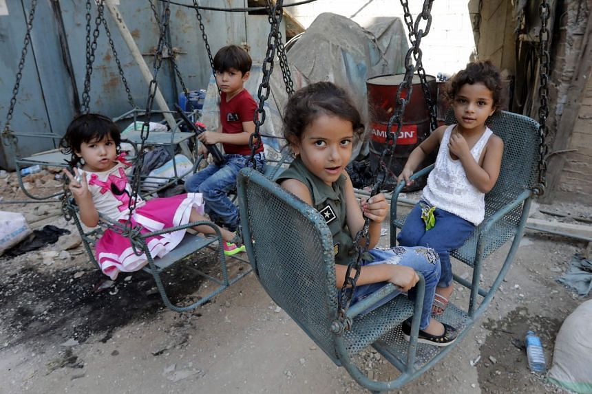Syrian refugee children play on a street in the Palestinian Shatila refugee camp, on the southern outskirts of the Lebanese capital Beirut, on Sept1, 2017,