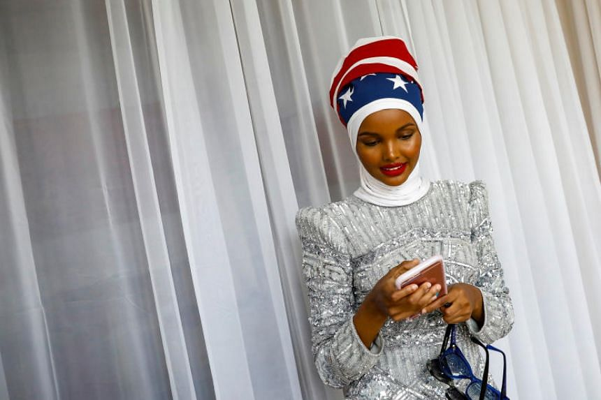 Halima Aden uses her phone during a shoot at a studio in New York City on Aug 28, 2017