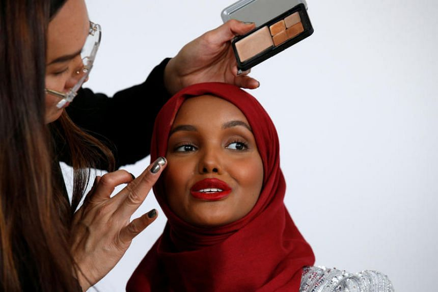 Halima Aden has her makeup applied during a shoot at a studio in New York City on Aug 28, 2017.