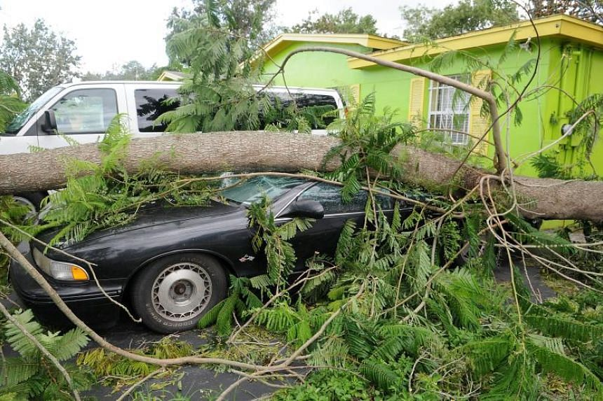 Hurricane Irma also left damage behind in Orlando, Florida, on Sept 11,  2017. Many areas remain under a dawn to dusk curfew.