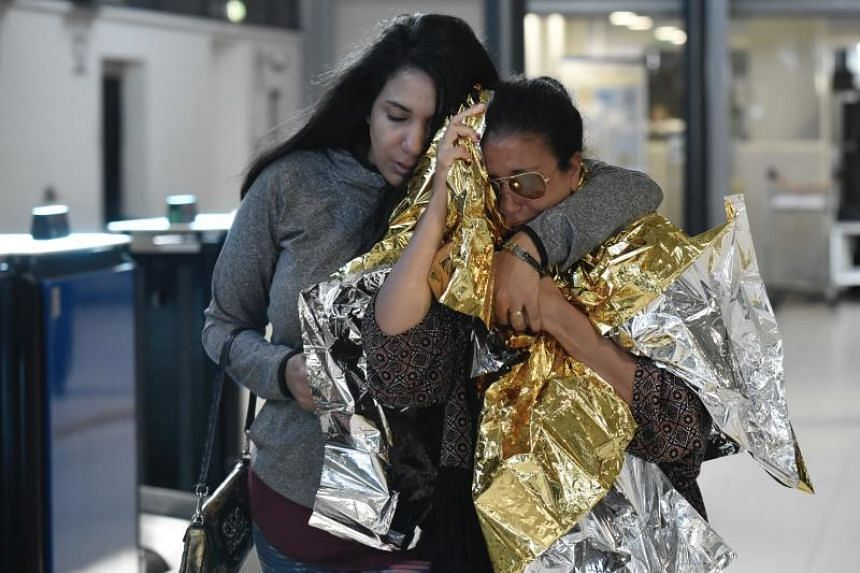 People evacuated from the French Caribbean island of Saint-Martin that was hit by Hurricane Irma arrive at the Roissy-Charles de Gaulle airport, north of Paris, on Sept 11, 2017.